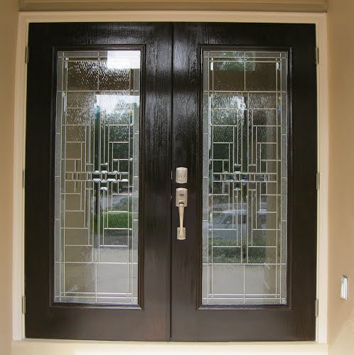 Stained front doors by Call Paul Painting